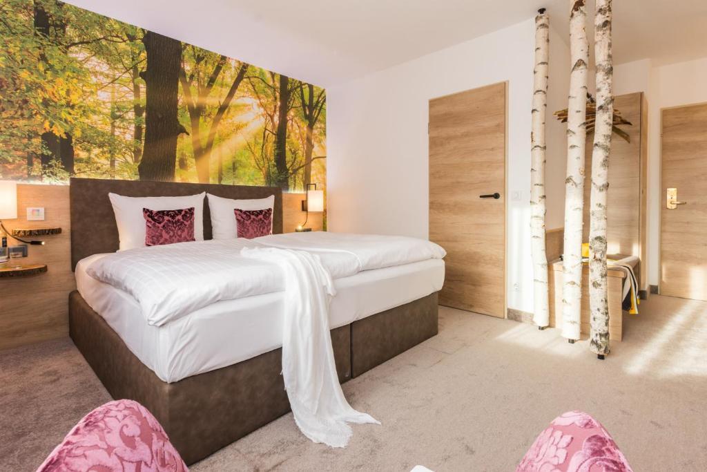 Ein Bett oder Betten in einem Zimmer der Unterkunft Trihotel - Wellnesshotel am Schweizer Wald