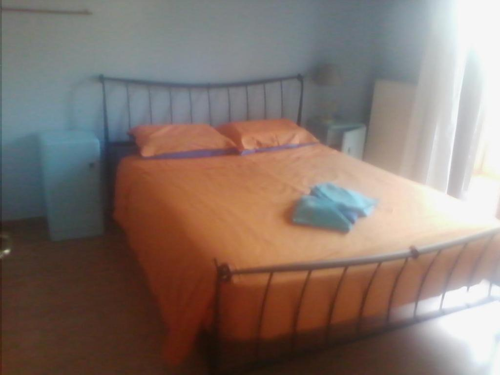 A bed or beds in a room at Prines Extra