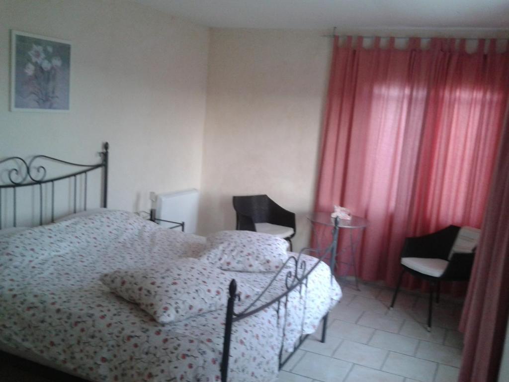 Llit o llits en una habitació de Chambres d'hôtes La Prairie