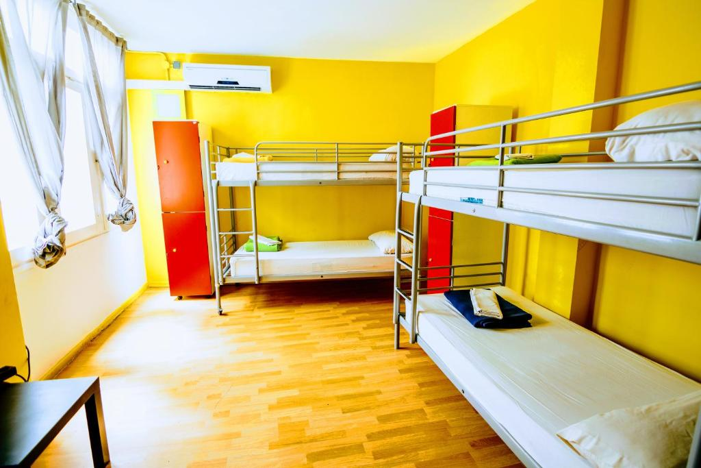 A bunk bed or bunk beds in a room at Feetup Yellow Nest Hostel Barcelona