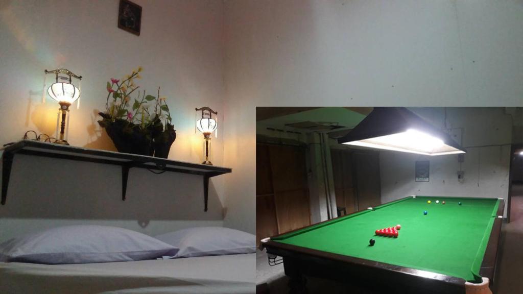A pool table at Adchara Mansion