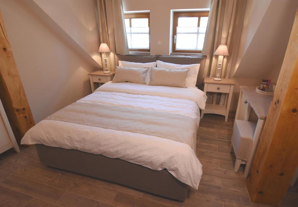 A bed or beds in a room at Janez Rooms