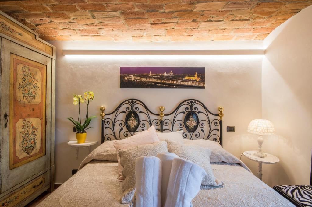 Letto o letti in una camera di Florence Luxury House