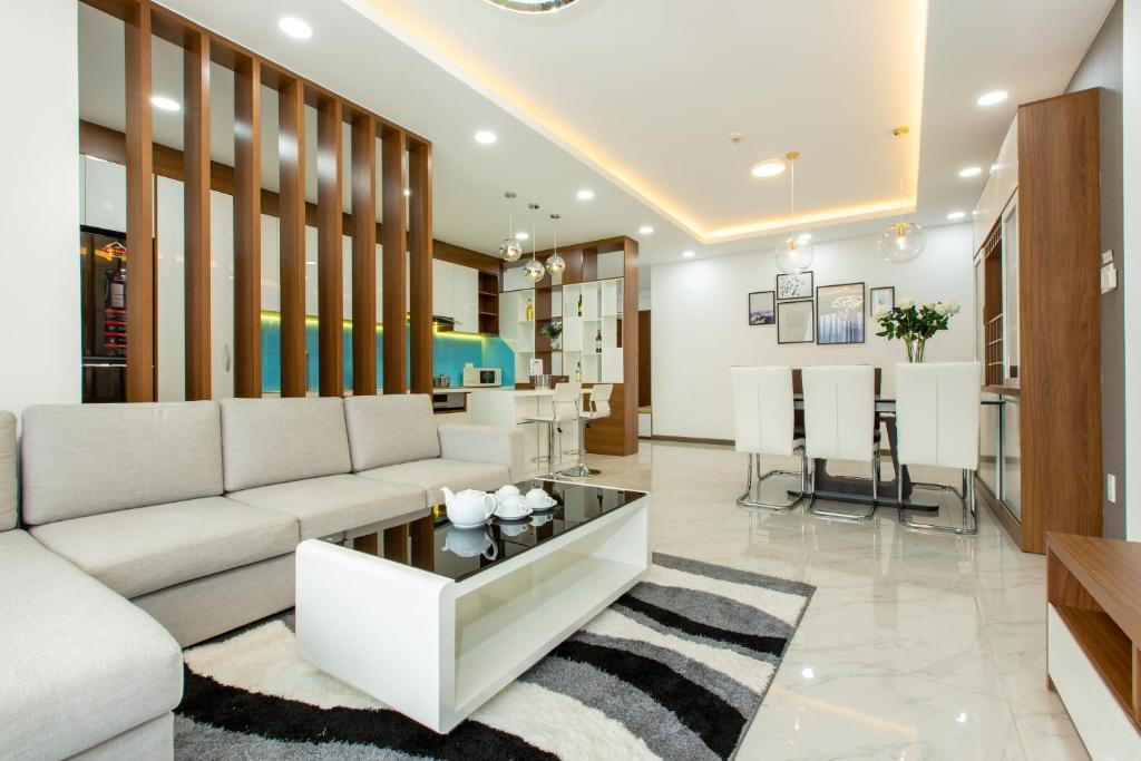 A seating area at LUXURY GOLD APARTMENT 5 - Rooftop Pool City View In the HEART HCM 1207