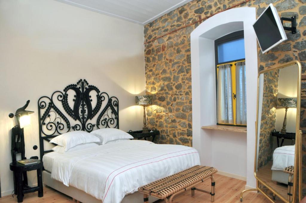 Ein Bett oder Betten in einem Zimmer der Unterkunft Leone Guest House