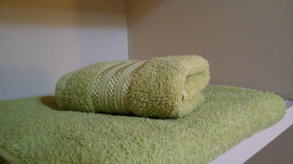 Una cama o camas en una habitación de Alójate Accommodation D4