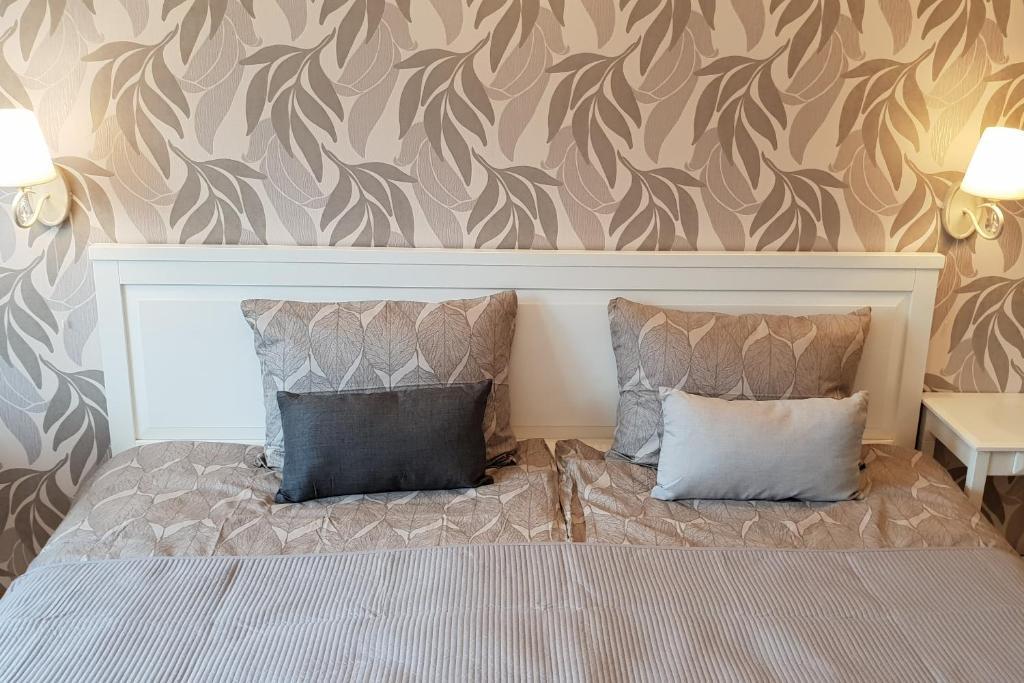 Gulta vai gultas numurā naktsmītnē Kraslava 2 Bedroom Lux Apartments