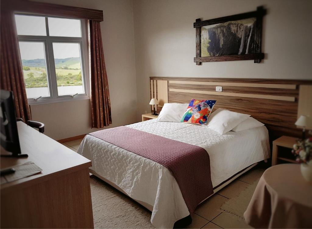 A bed or beds in a room at Cambará Eco Hotel
