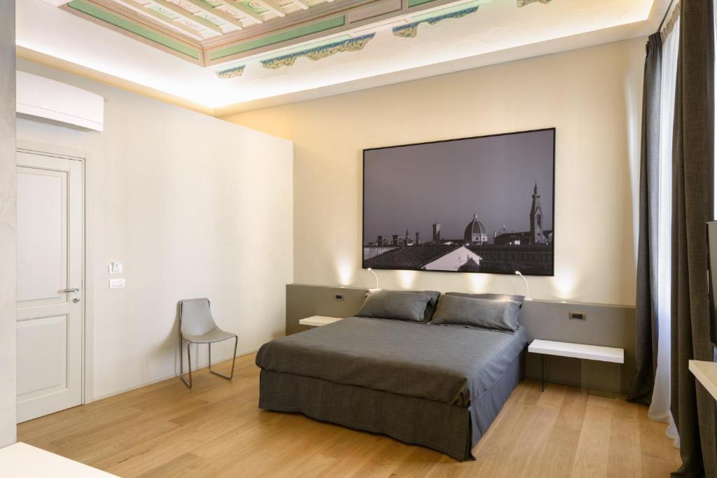 Letto o letti in una camera di Palazzo Vasarri - Luxury design suites