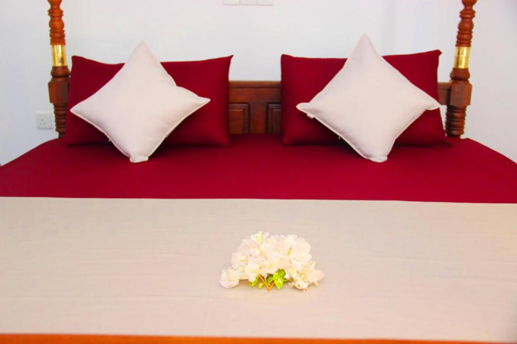 A bed or beds in a room at Sooriya Sewana Guest House