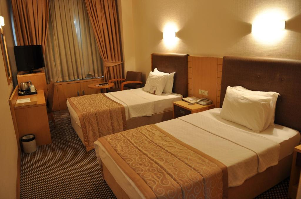 Lova arba lovos apgyvendinimo įstaigoje Surmeli Adana Hotel