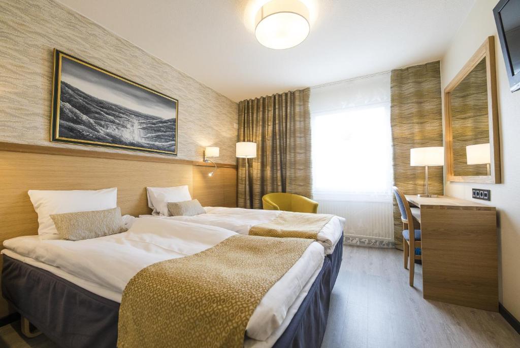 Cama o camas de una habitación en Hotel Aakenus