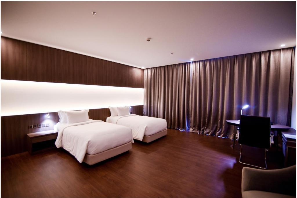 Phòng Deluxe 2 Giường Đơn Nhìn Ra Thành Phố - Minibar Miễn Phí