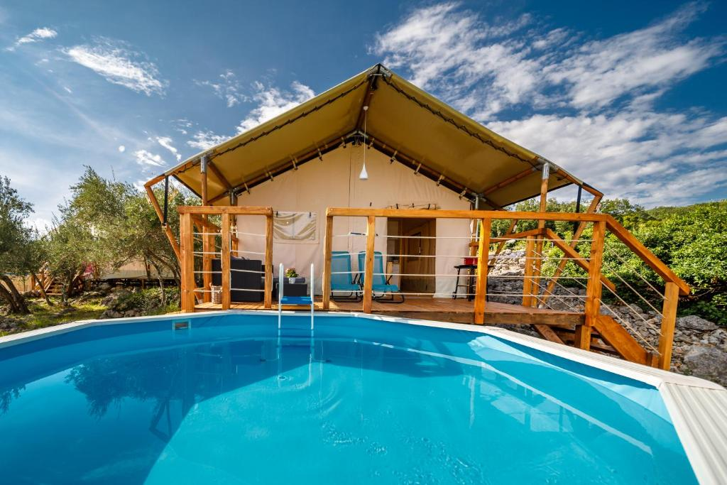 The swimming pool at or near Krk glamping village
