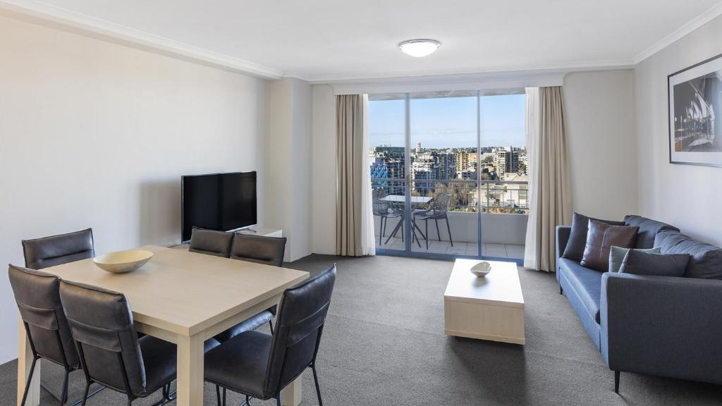 A television and/or entertainment center at Oaks Sydney Castlereagh Suites
