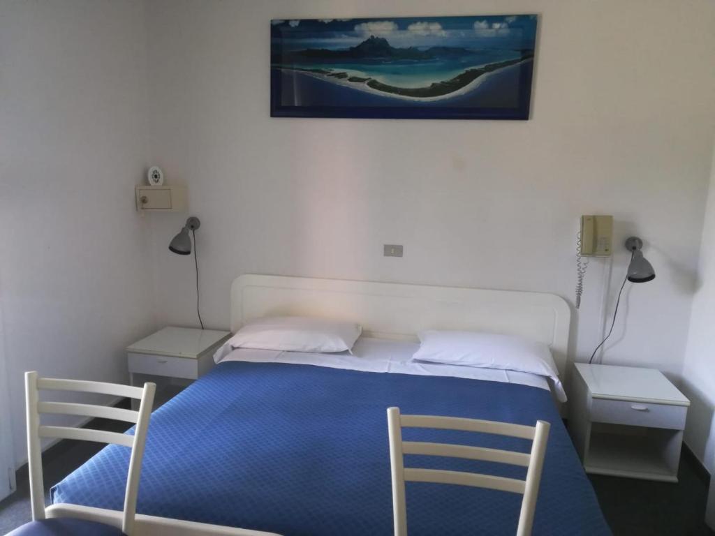 Letto o letti in una camera di Hotel Tuscolano