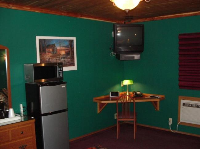 A television and/or entertainment center at Comfort Zone Inn