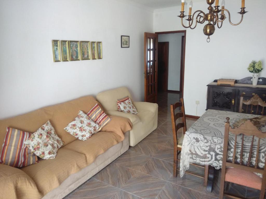 Uma área de estar em Apartamento Soares