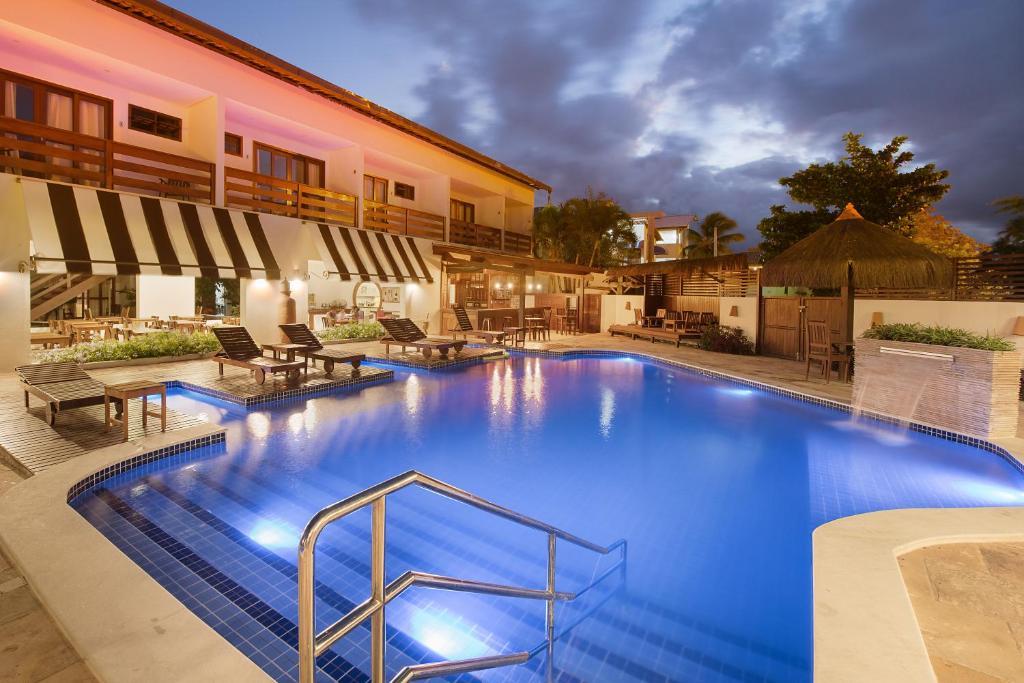 The swimming pool at or near Pousada Quatro Estações