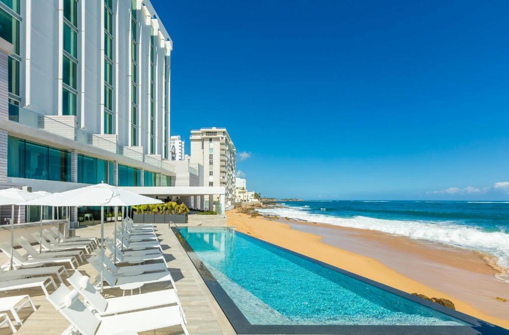 The swimming pool at or near Serafina Beach Hotel