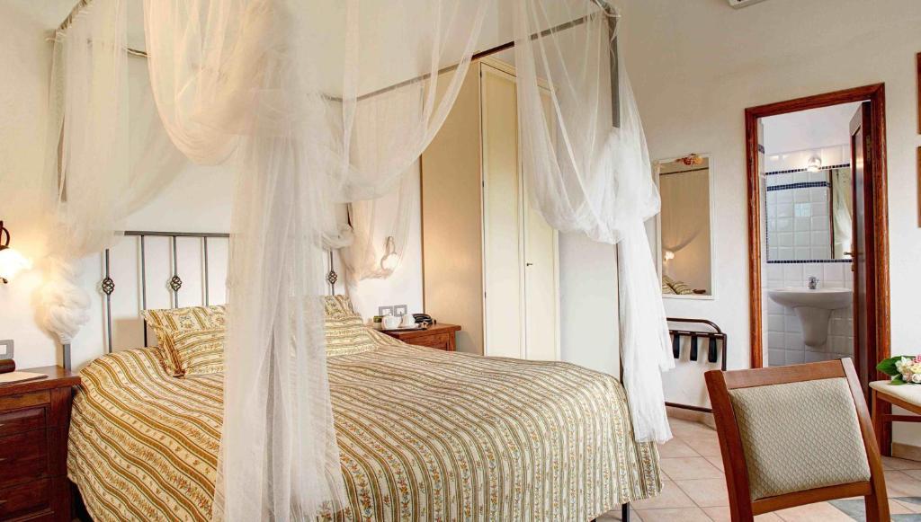Ein Bett oder Betten in einem Zimmer der Unterkunft Locanda Del Borgo