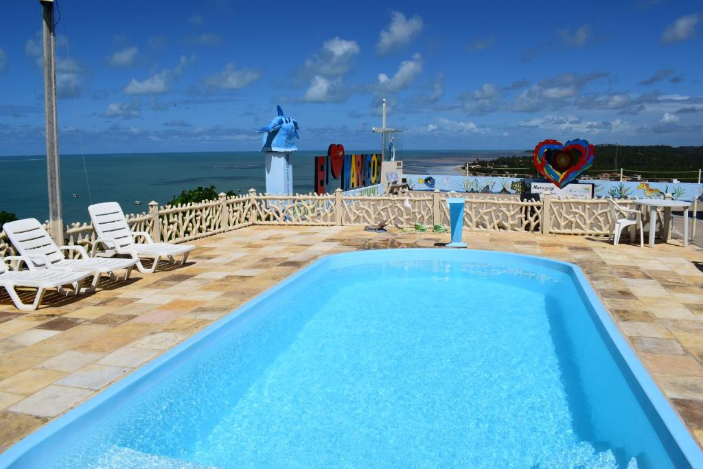 The swimming pool at or near Pousada Alto do Cruzeiro