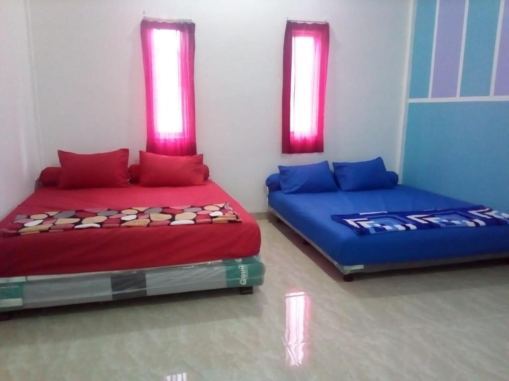 A bed or beds in a room at Almira homestay