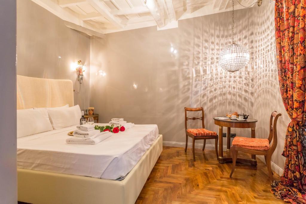 Um restaurante ou outro lugar para comer em Luxury Campo De Fiori