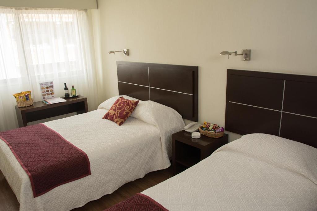 Vuode tai vuoteita majoituspaikassa Hotel Europa