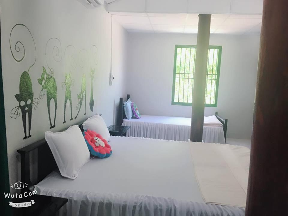 Giường trong phòng chung tại Tam Thanh Homestay