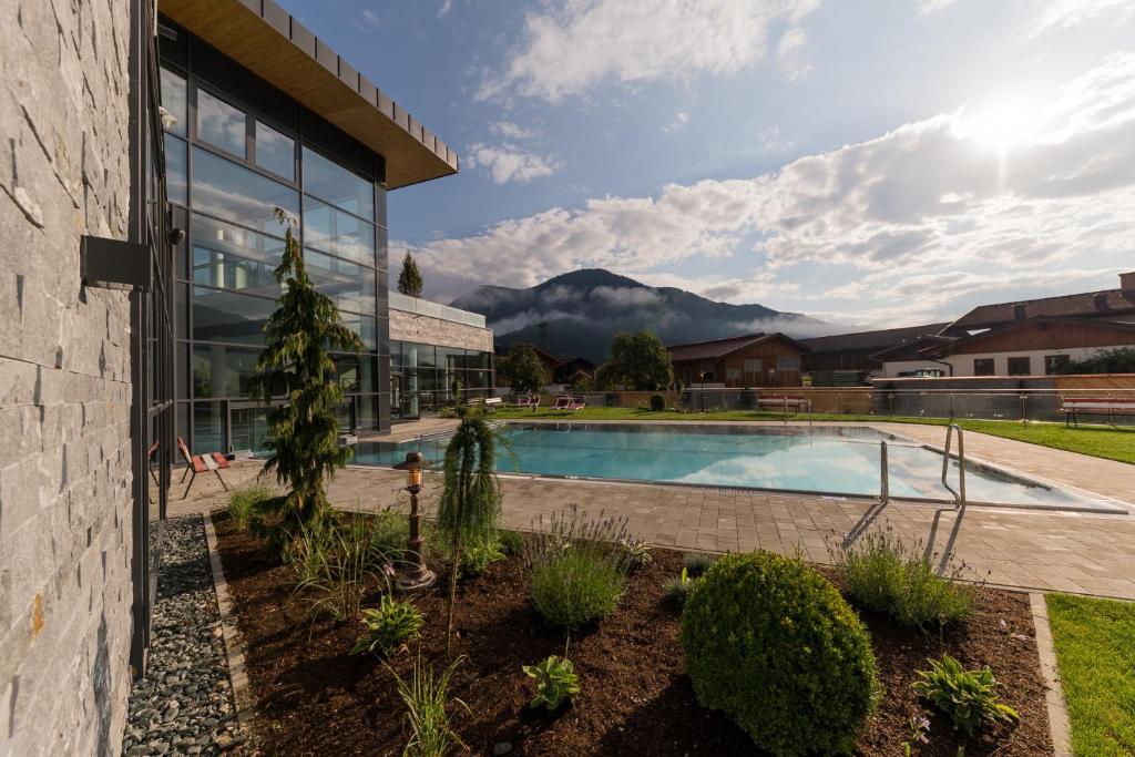 The swimming pool at or near Woferlgut - Wellness & Sport