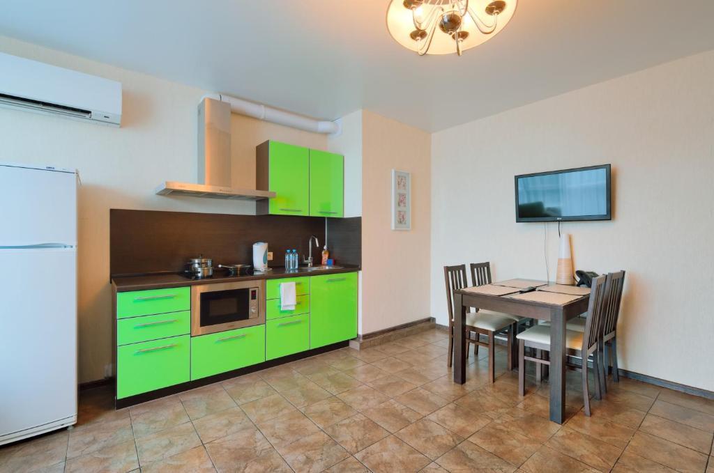 Кухня или мини-кухня в Отель Дегас Лайт
