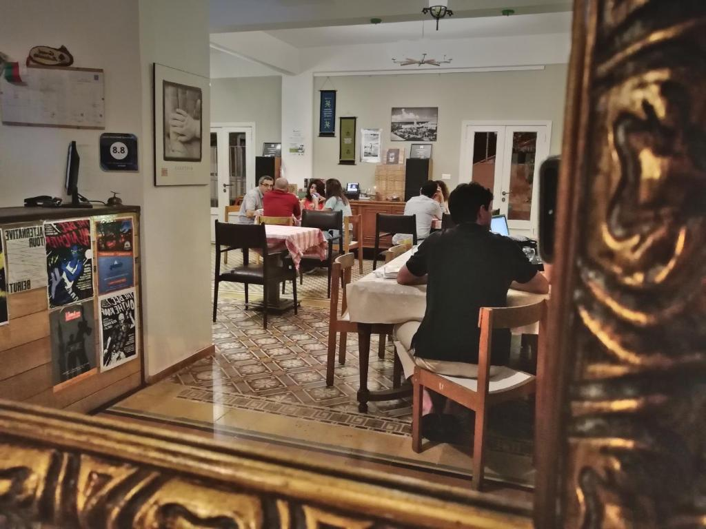 A restaurant or other place to eat at The Grand Meshmosh Hotel