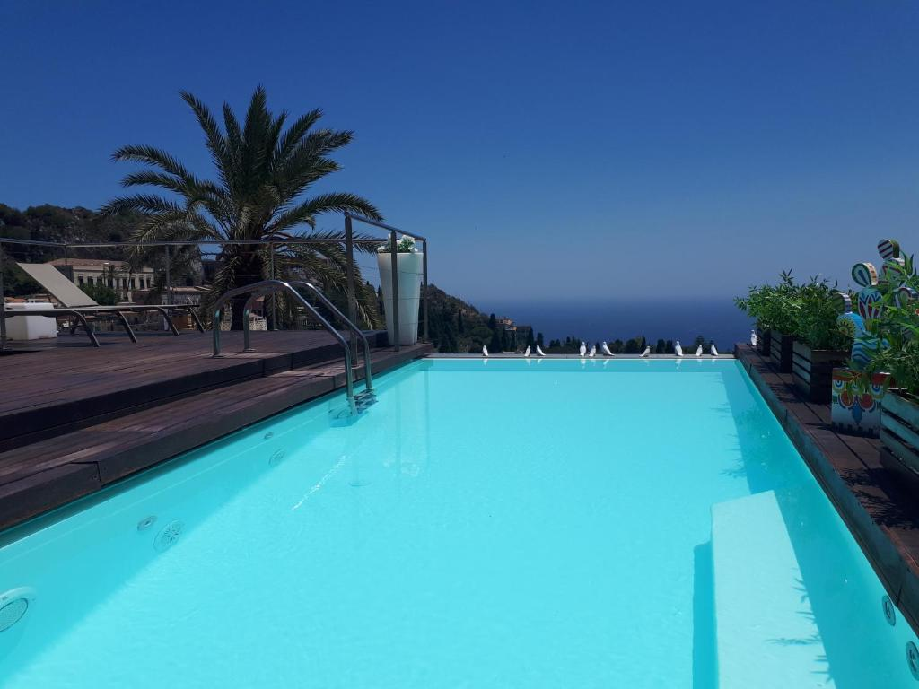 The swimming pool at or near Il Piccolo Giardino GH ***Superior