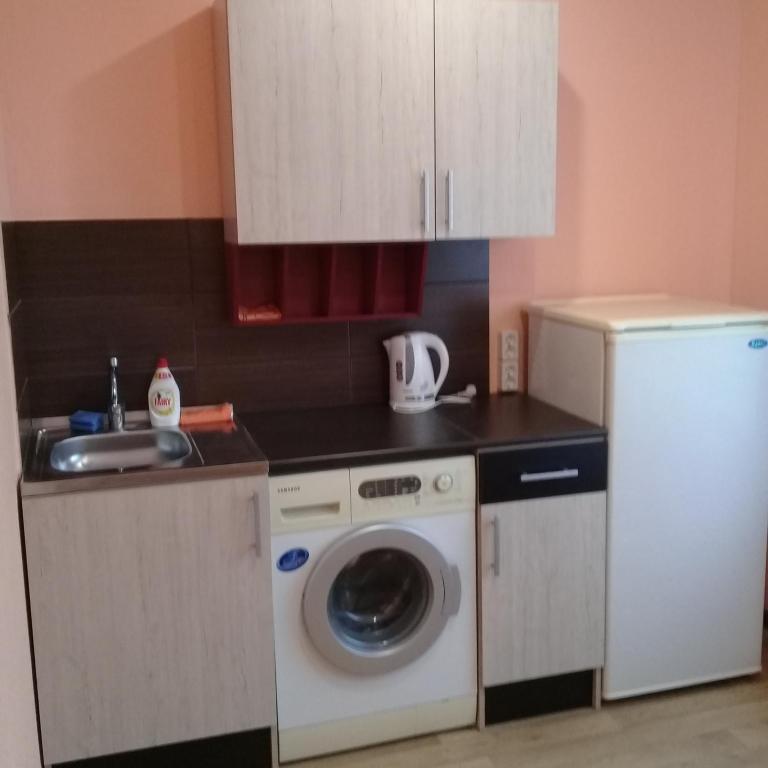 Una cocina o zona de cocina en Квартира 2-х комнатная на Советской 11