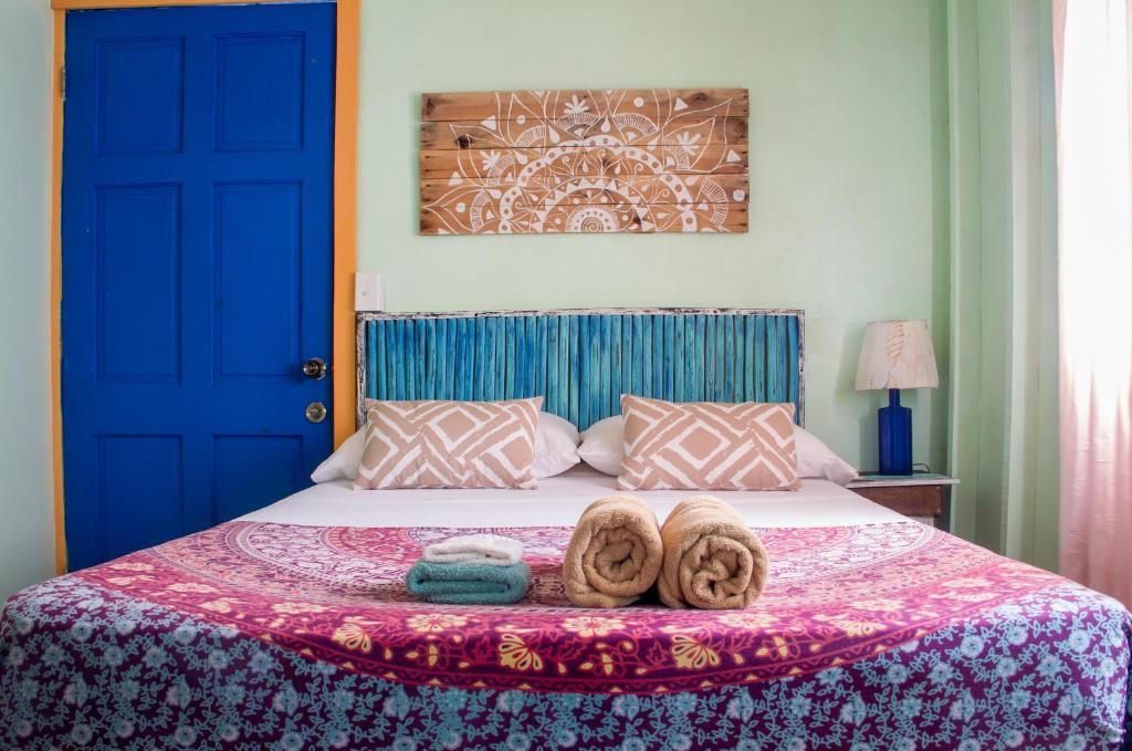 A bed or beds in a room at Maroa Beach House