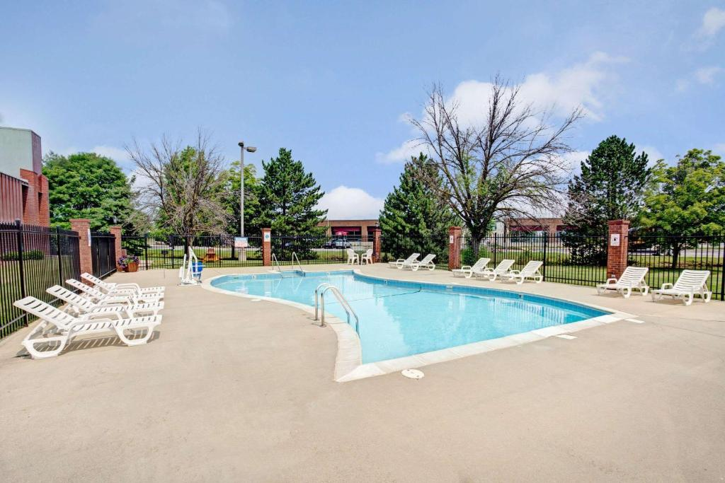 The swimming pool at or near Baymont by Wyndham Indianapolis West
