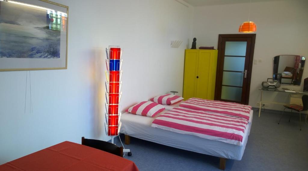 Een bed of bedden in een kamer bij B&B Oostende