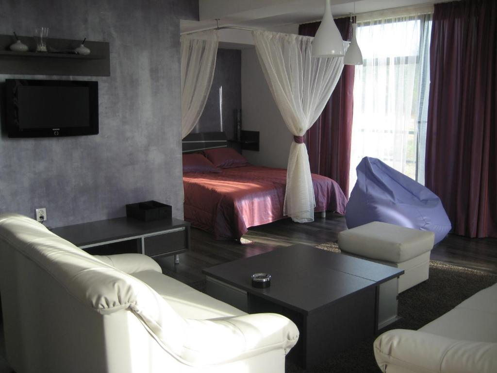 A bed or beds in a room at APART Studios Blagoevgrad