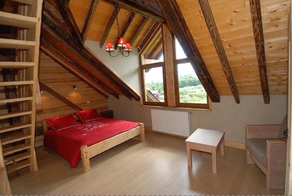 Un ou plusieurs lits dans un hébergement de l'établissement La Ferme De Noémie