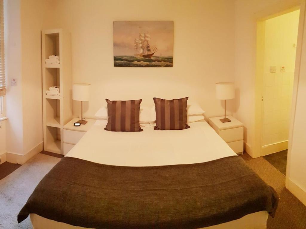 Letto o letti in una camera di Apartment Pimlico & Victoria