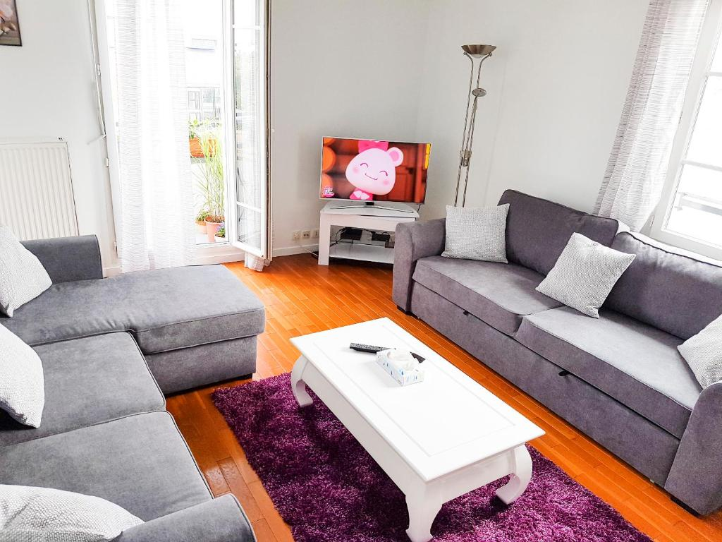 A seating area at Smart apartment Val d'Europe 7/9 pers