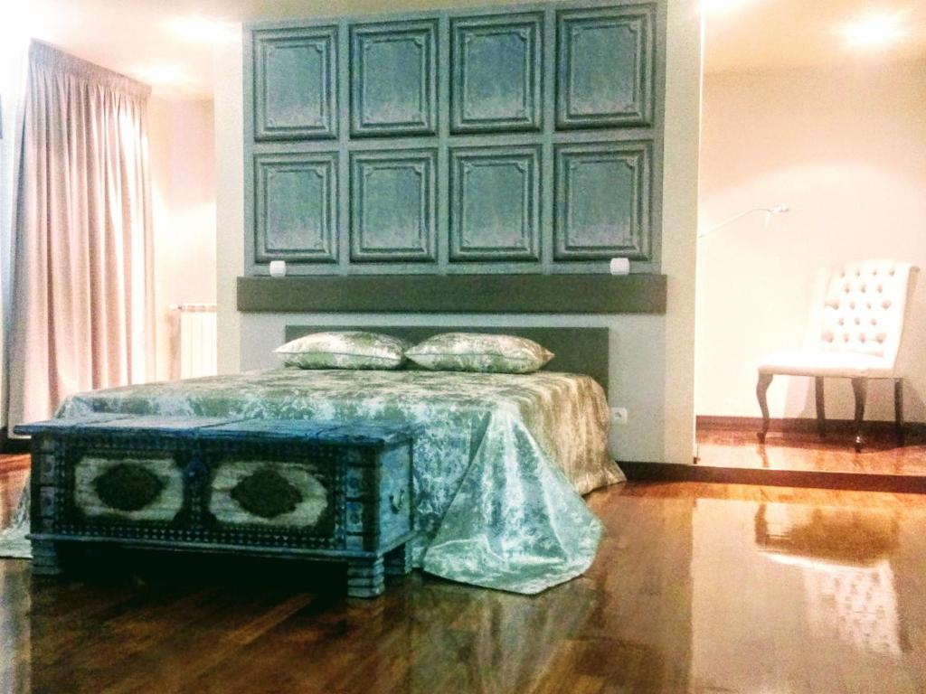 A bed or beds in a room at Aveleda Village