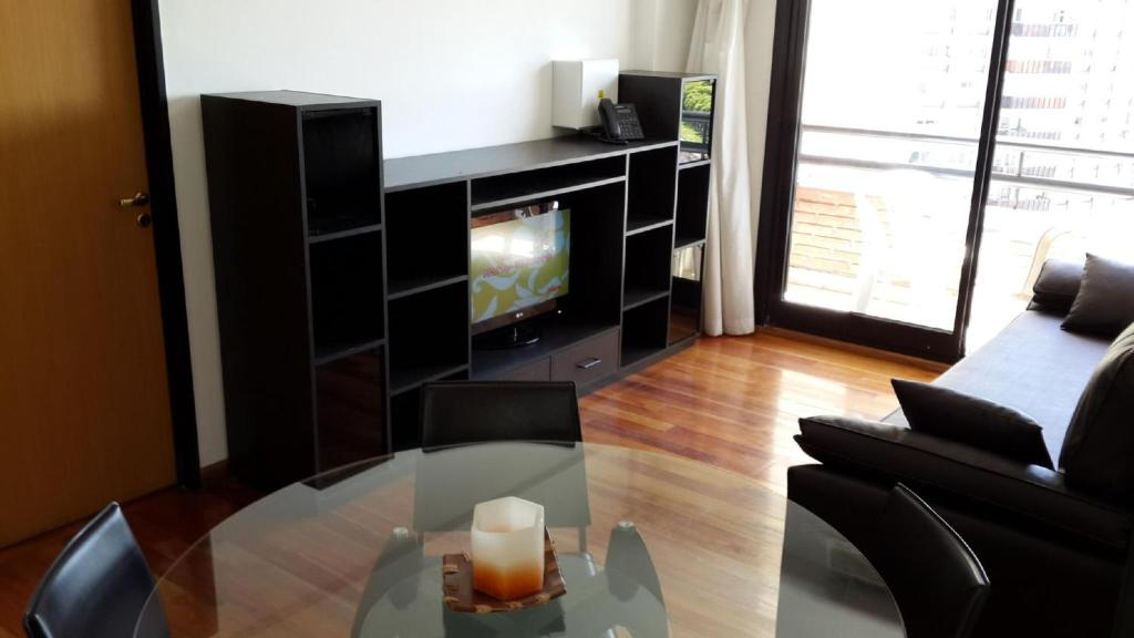 A television and/or entertainment center at Rent Buenos Aires - Temporary Apartments