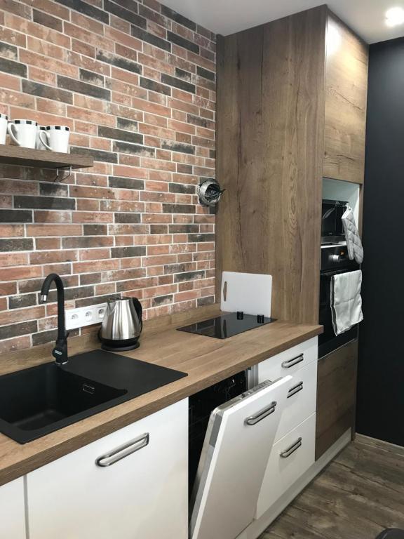 Кухня или кухненски бокс в Apartment Kubo
