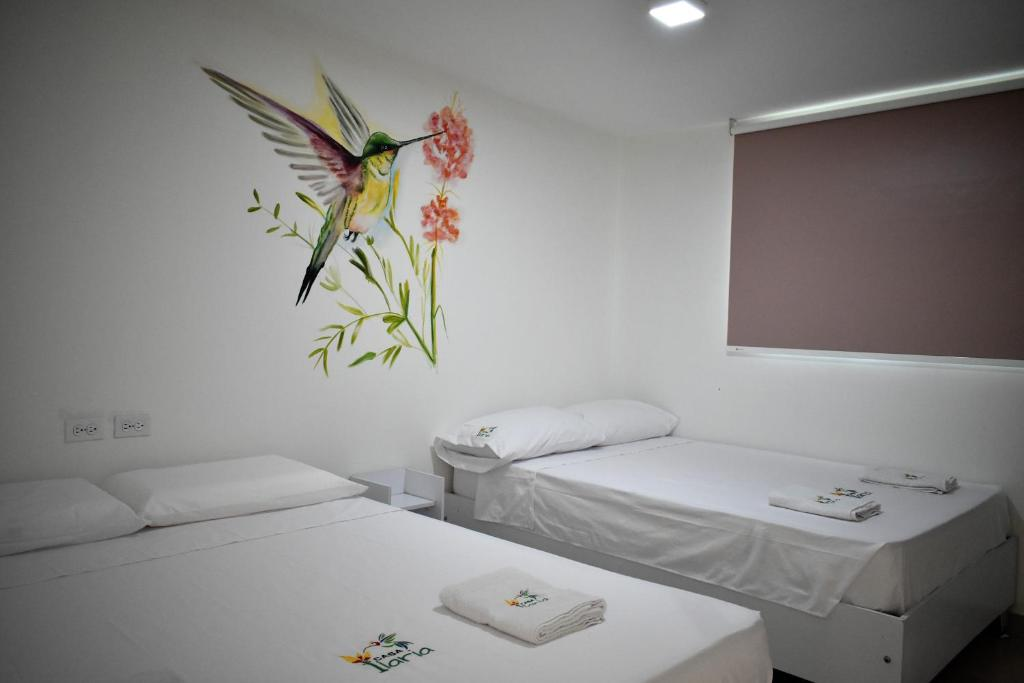 A bed or beds in a room at Casa Ilaria