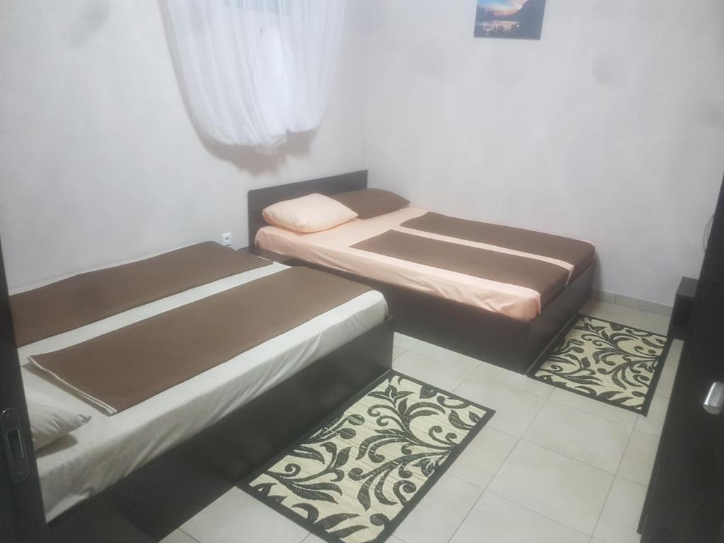 A bed or beds in a room at Varaksa Apart Hotel
