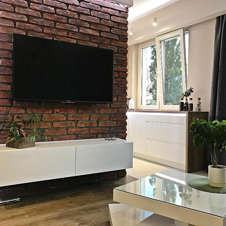 A television and/or entertainment centre at Pure Apartment