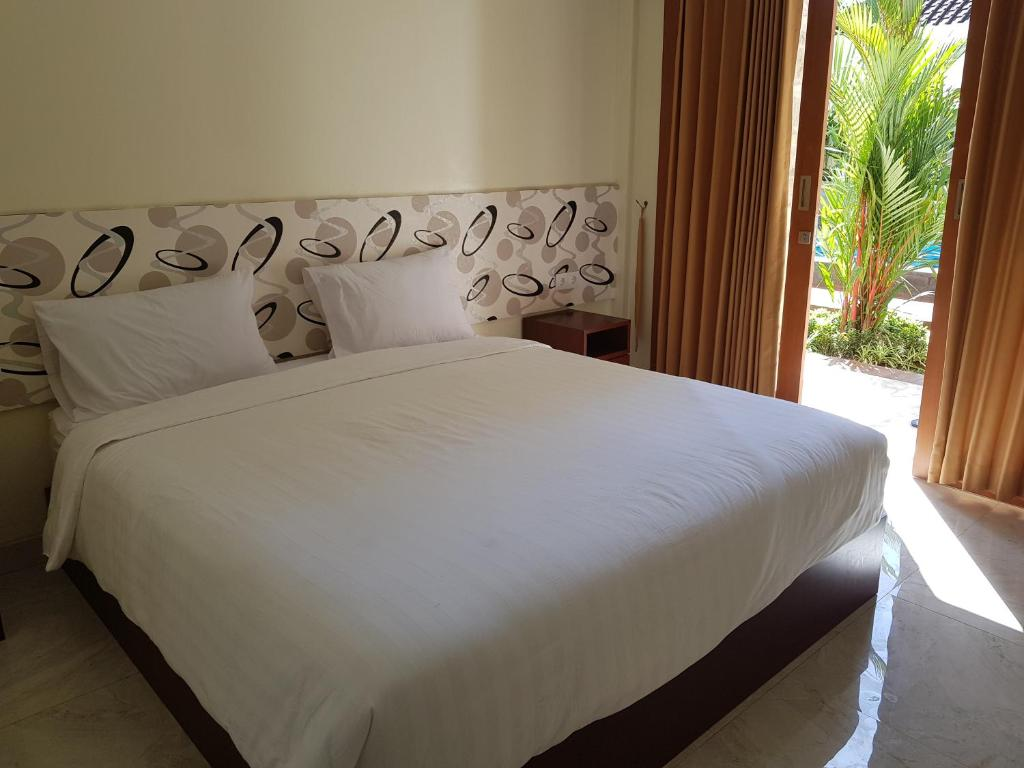 A bed or beds in a room at Praba Guesthouse