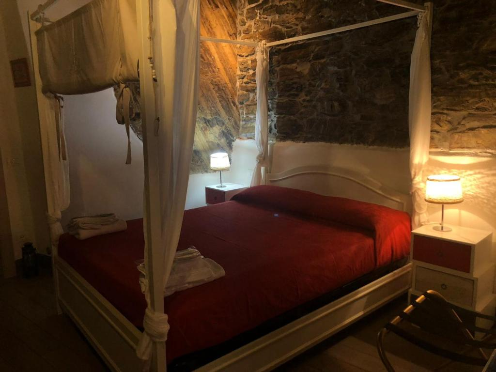 A bed or beds in a room at Cantina del Pescatore